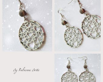 Earrings with silver color bead.