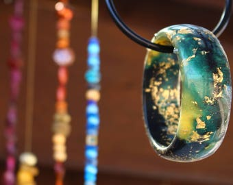 This beautiful bangle was inspired by a stormy day and is handmade with resin,