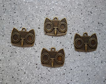 4 owls charms metal bronze 15 x 20 mm approx