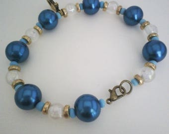 Sailor bracelet with anchor and blue beads and gold
