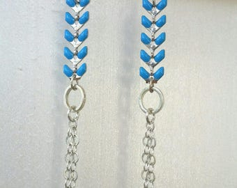 Blue and silver spike chain earrings.