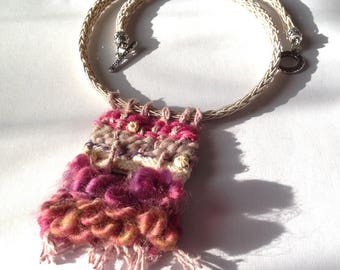 Ethnic handwoven necklace on a braided string