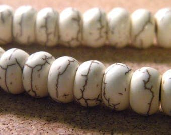 howlite synthetic abacus-howlite-ivory-10 mm PE250 30 beads