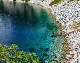 Blue alpine lake and rocky shore