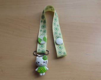 Pacifier clip yellow and green for baby.