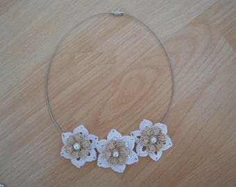 white flowered necklaces