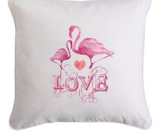 Pillows with decorative pink flamingo