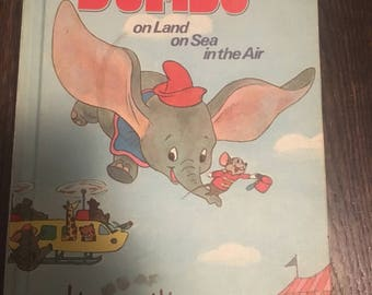Dumbo on Land on Sea in the Air