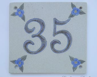 Door number '35' ceramic (stoneware), linen flowers blue on beige background