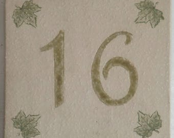 Door plate beige stoneware, number 16, ivy leaves