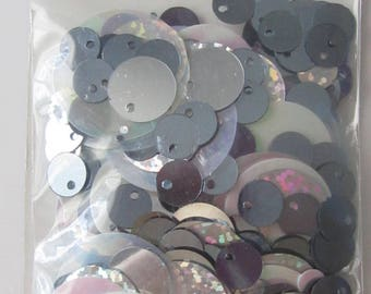 Bag of glitter, sequins, .argentees shaped circles of different sizes