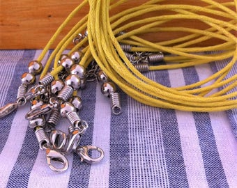 2 necklaces in cord with clasps and extension chains, mustard yellow cotton
