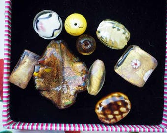 Set of 9 styles glass beads different leaf, rectangular, round oval in shades of brown-yellow