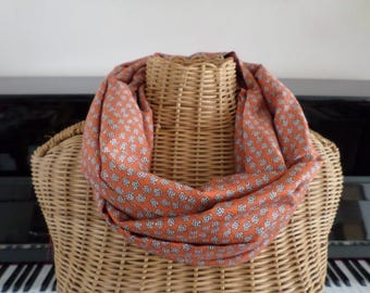snood is orange with small white flowers and black