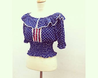 Top size portion with dots and vintage lace and frill collar
