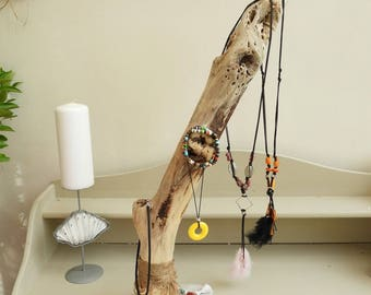 Bohemian style driftwood and concrete jewelry display. Bohemian decor