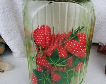 Green Glass Jar filled with Plush Strawberries