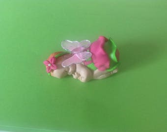 polymer clay with a butterfly baby