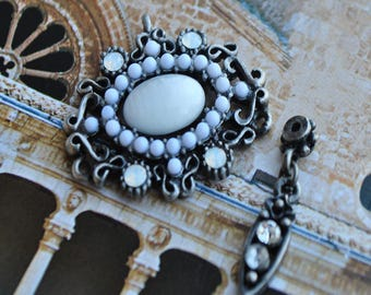 White glass and antique silver connector charms
