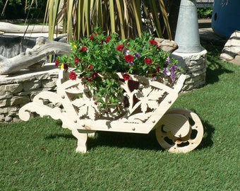Wheelbarrow with wood cut out for decoration