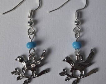 Earrings with birds and beads
