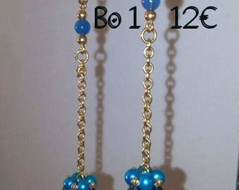 Woven beads on gold chain earrings