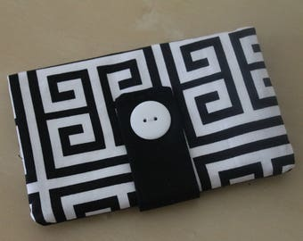 Roll in black and white fabric pouch