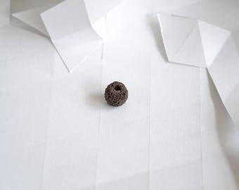 1 dark brown lava bead