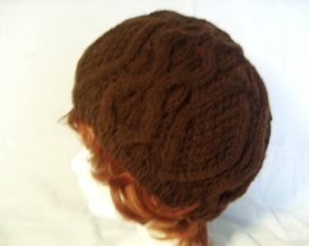 Knitted hat in dark brown Irish knit stitch