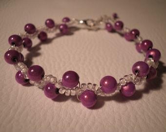 01321 - Magic and seed pearl bracelet purple and white tone