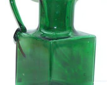 Green blown glass jug