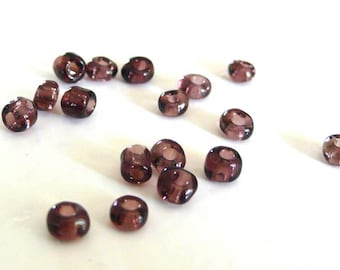 Large seed beads purple clear 10g