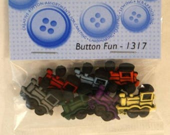 "7 novelty buttons - ""trains""."
