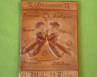 "Zodiac sign ""Gemini"" leather embossed, glued on wood"