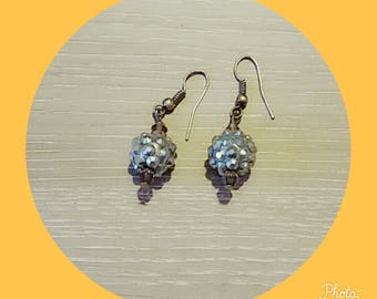 earring with a silver bead