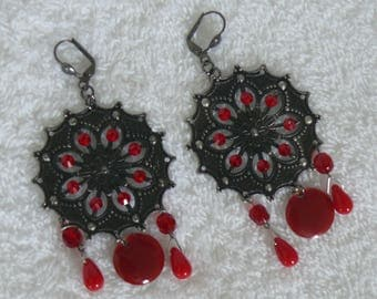 single earring with silver print and red beads