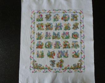 alphabet animal cross-stitch on white aida canvas