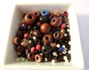 Assortment of seed beads and wood - creating jewelry