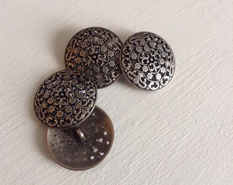 4 large metal buttons
