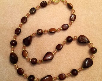 Brown and Gold coloured bead necklace with gold plated toggle clasp