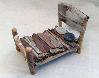Fairy Mini Miniature Rustic Bed Made With Tree Twigs, A Mattress Made From Tree Bark, Stones For The Pillows and A Feathered Headboard