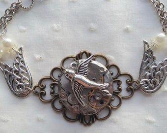 Bird with a watch gear steampunk bracelet