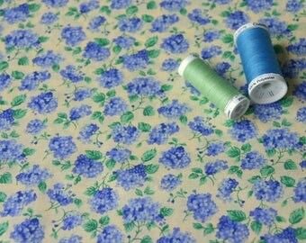 Patchwork blue flowers on pale yellow fabric