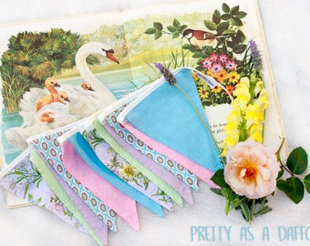 Pretty as a daffodil vintage/retro pink, blue and purple inspired fabric bunting perfect for girl's nursery or bedroom