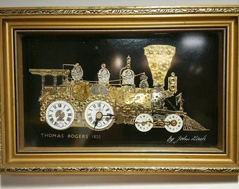 Framed three dimensional artwork of Thomas Rogers 1855 train steam locomotive signed by John Nash with a functional clock