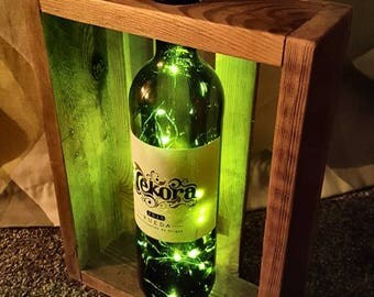 Wine bottle crate led lamp, reclaimed hardwood and 20 battery operated led lights.