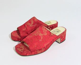 Red 90s platform slip ons with floral embroidery by Anne Michelle