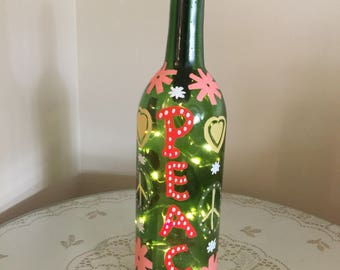 Painted recycled wine bottle with lights