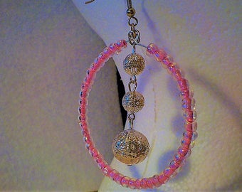Pink hoops with a dangle.