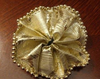 Golden flower collar bow